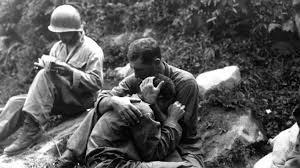 soldiers hugging