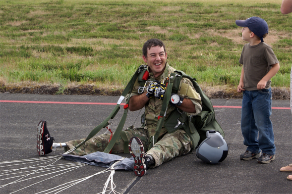 Staff Sgt. Shaun Meadows shares a laugh with his son after completing his jump June 14, 2010. Sergeant Meadows is assigned to the 22nd Special Tactics Squadron at Joint Base Lewis-McChord, Wash. (U.S. Air Force photo/Airman Leah Young)