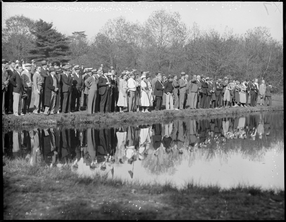 Title: Crowd reflected in water while watching Sarazen and Ouimet duel at Weston Country Club
