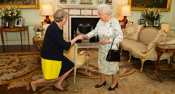 LONDON, ENGLAND - JULY 13:  Queen Elizabeth II welcomes Theresa May at the start of an audience where she invited the former Home Secretary to become Prime Minister and form a new government at  Buckingham Palace on July 13, 2016 in London, England. Former Home Secretary Theresa May becomes the UK's second female Prime Minister after she was selected unopposed by Conservative MPs to be their new party leader. She is currently MP for Maidenhead. (Photo by Dominic Lipinski - WPA Pool/Getty Images)