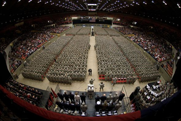 32nd Brigade Command Sgt. Maj. Ed Hansen, on floor in front of podium, accepts reports from battalion command sergeants major as the brigade forms at the start of the Feb. 17 send-off ceremony at the Dane County Veterans Memorial Coliseum, Madison, Wis. Family members and public officials bade farewell to some 3,200 members of the 32nd Infantry Brigade Combat Team and augmenting units, Wisconsin Army National Guard, in the ceremony. The unit is bound for pre-deployment training at Fort Bliss, Texas, followed by a deployment of approximately 10 months for Operation Iraqi Freedom. Wisconsin Department of Military Affairs photo by Larry Sommers.