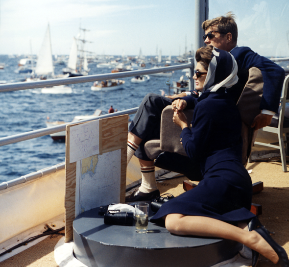 Watching the America's Cup Race. Mrs. Kennedy, President Kennedy, others. Off Newport, RI, aboard the USS Joseph P. Kennedy, Jr. by Robert Knudsen
