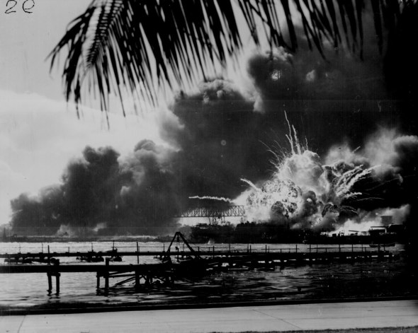 """USS SHAW exploding during the Japanese raid on Pearl Harbor."" December 7, 1941. 80-G-16871. From the National Archives"